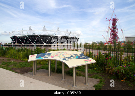 The London 2012 Olympic stadium, the ArcelorMittal Orbit observation tower and site map in the Olympic Park in Stratford, London
