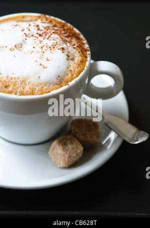 Cappuccino in white cup - Stock Photo