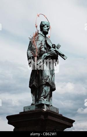 Statue of St. John of Nepomuk on the Charles bridge, Prague, Czech republic - Stock Photo