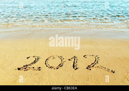 New Year is coming concept - the inscription '2012' on a beach sand - Stock Photo