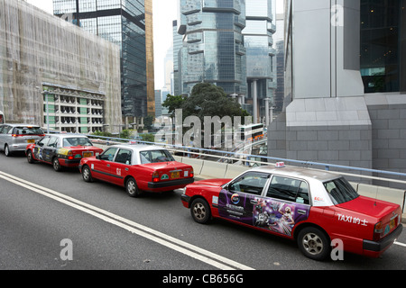 row of taxis stuck in traffic on elevated road in the central district, hong kong island, hksar, china - Stock Photo