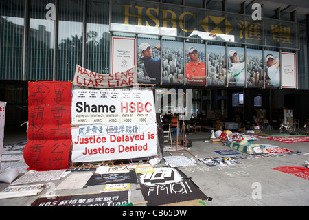 occupy hong kong and banking protests at hsbc hong kong and shanghai banking corporation headquarters central district - Stock Photo