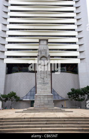 the hong kong cenotaph war memorial in statue square in front of the hong kong club building central district, hong - Stock Photo