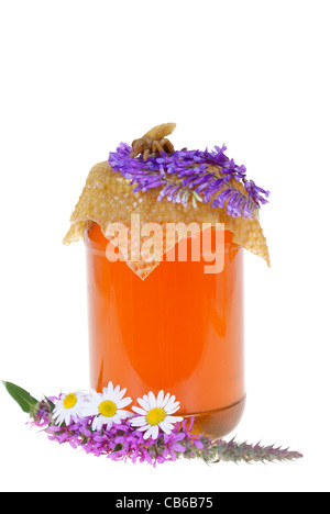 honey in jar and flowers isolated on white background - Stock Photo
