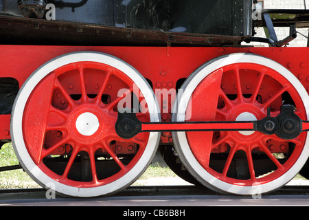 Red and white old steam locomotive wheels close-up. - Stock Photo
