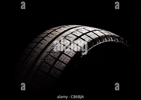 Brand new car tyre. Isolated on a white backgrond. - Stock Photo