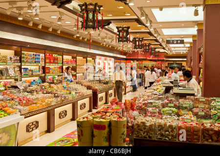 Inside a chinese indoor market food items for sale Shanghai Nanjing road east, PRC, People's Republic of China, - Stock Photo