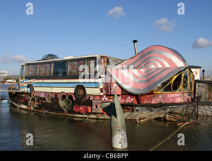 One of the houseboats on the river Adur at Shoreham West Sussex, UK, with an upturned torpedo in the foreground - Stock Photo