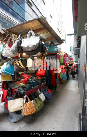 small fashion shops stands in li yuen street market alleyway central district, hong kong island, hksar, china - Stock Photo