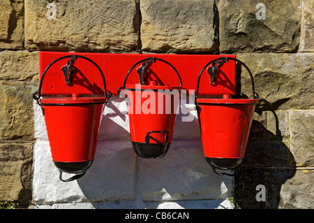 Close up of red fire busket buckets at Goathland Station North Yorkshire Moors Railway North Yorkshire England UK United Kingdom GB Great Britain