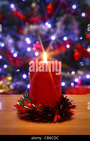 Photo of a Christmas candle with starburst, - Stock Photo