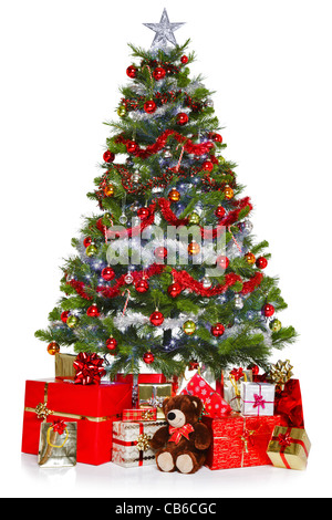 Photo of a Christmas tree with decorations and lights surrounded by presents, isolated on a white background. - Stock Photo