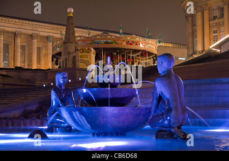 Youth statues in Victoria Square Birmingham at night - Stock Photo