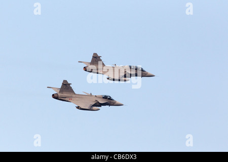 Swedish Air Force Saab JAS 39C and 39D Gripens climbing after taking off - Stock Photo