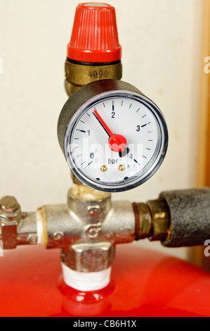 Thermal expansion tank with pressure gauge in a domestic pressurised ...