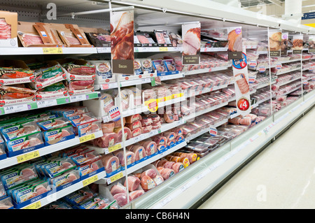Chilled meat shelves in a Tesco store - Stock Photo