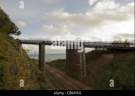 Foot bridge crossing the railway between Teignmouth and Dawlish In South Devon - Stock Photo