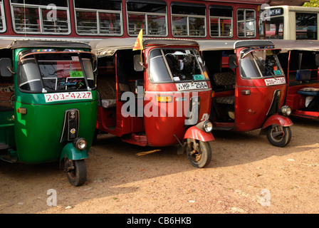 Row of traditional Asian tuk tuk taxis standing near the bus station on Sri Lanka - Stock Photo