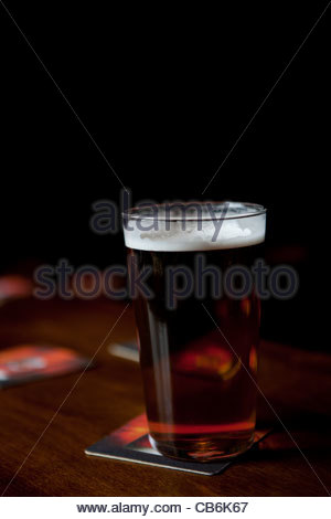 Pint of traditional British beer in straight glass Crown Inn, Beeston - Stock Photo