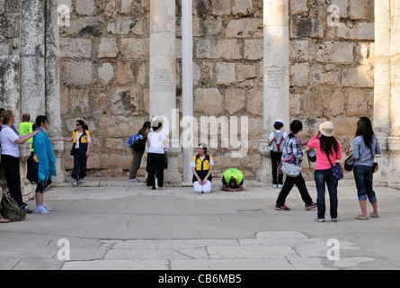 Two people praying in ruins of 4th century  synagogue,Capernaum, Galilee, Israel,Asia, Middle East - Stock Photo