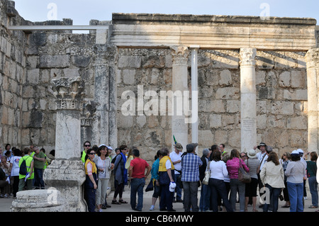 Tourists inside ruins of 4th century ancient synagogue, Capernaum, Galilee, Israel,Asia, Middle East - Stock Photo
