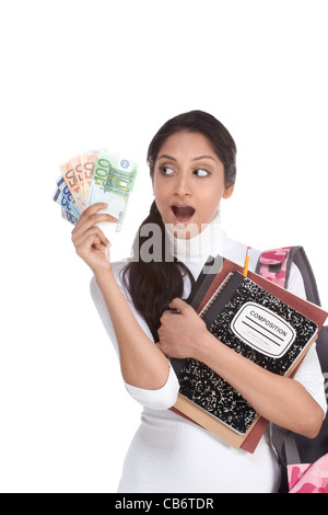Ethnic Indian college student holds pile 100 (one hundred), 50 (fifty) and 20 (twenty) euro bills happy getting - Stock Photo