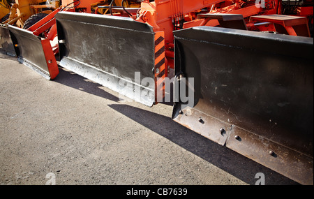 Heavy construction machines in mint condition ,focus on nearest - Stock Photo