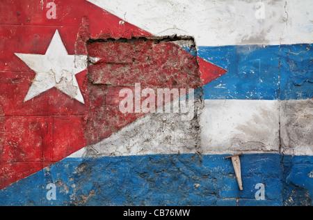 A Cuban Flag painted in the crumbling walls of Old Havana (La Habana), Cuba - Stock Photo