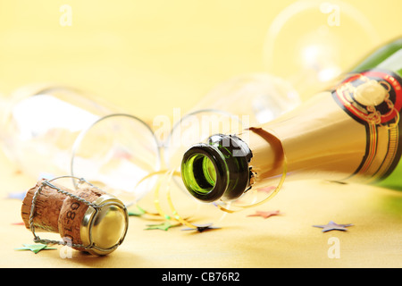 Champagne bottle with empty glasses,Shallow Dof. - Stock Photo