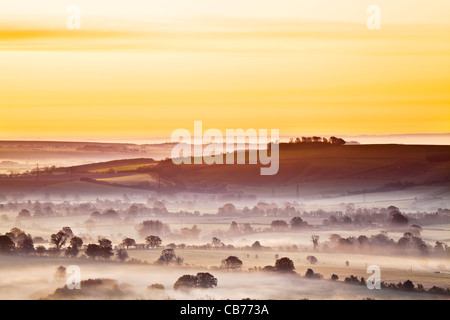 A winter sunrise view from Martinsell Hill over the Vale of Pewsey in Wiltshire, England, UK - Stock Photo