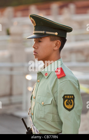 Young male chinese soldier guarding the entrance to the Tiananmen Tower Gate of Heavenly Peace, Beijing, China, - Stock Photo