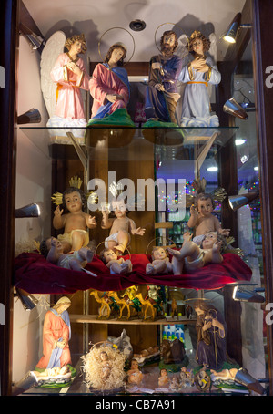 Catholic Christmas figures or statuettes for sale as decor accessories at a shop in Gozo in Malta. - Stock Photo