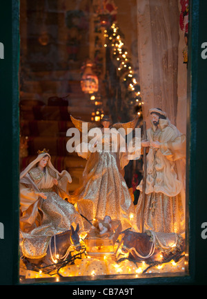 Christmas time decor set up in the front room of private townhouses in Gozo in Malta. - Stock Photo