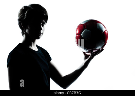one  young teenager silhouette boy girl holding showing soccer football portrait in studio cut out isolated on white - Stock Photo