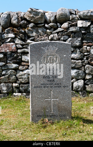 Second World War gravestone of an unknown Merchant Navy sailor in Cladh Mhuire graveyard on Benbecula in the Outer - Stock Photo