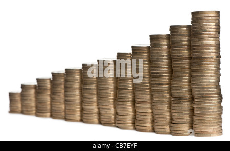 Stacks of 1 Euro Coins in front of white background - Stock Photo