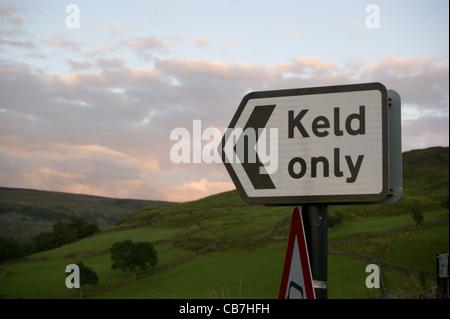 Road sign showing 'Keld only', at sunset,Keld, North Yorkshire, England Yorkshire Dales National Park - Stock Photo