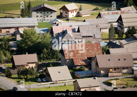 Tin roofs of houses in the French village of Brunissard, Hautes-Alpes, Provence-Alpes-Côte d'Azur, France. - Stock Photo