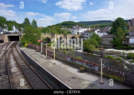 Llangollen Station and stone bridge across the River Dee,  Llangollen, Denbighshire, Wales, Cymru, UK, United Kingdom, - Stock Photo