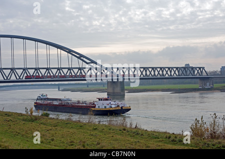 Commercial barges sailing on river Rhine, Dusseldorf, Germany. - Stock Photo