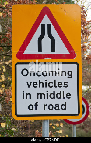 Warning road sign 'Oncoming vehicles in middle of road' - Stock Photo