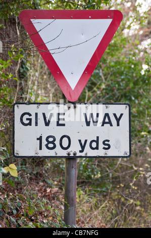 UK road sign 'Give way 180 yards'. - Stock Photo