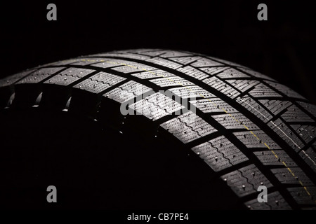 Part of brand new car tyre. Horizontal composition. Stock Photo