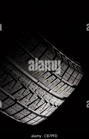 Part of unused car tyre. Vertical composition. Stock Photo
