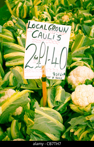 Fresh cauliflowers for sale at an english market - Stock Photo
