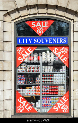 Shop front & window display shelves stacked with tourism souvenirs & gifts of London popular with tourists in Oxford - Stock Photo