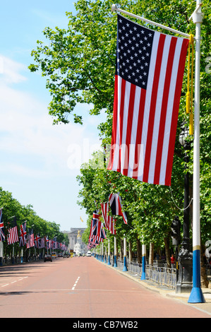 Stars & Stripes American Flag & Union Flag of the United Kingdom flying from flagpoles in the Mall London for visit - Stock Photo