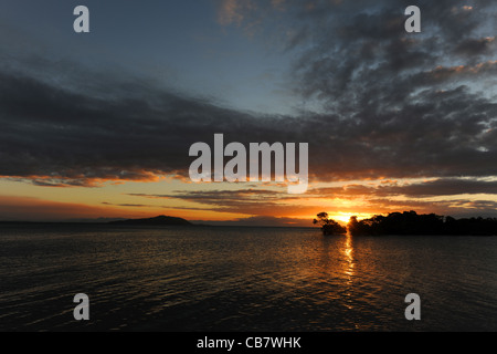 sunset over sea and mangroves at Cockle Bay, Magnetic Island, Townsville, Queensland, Australia - Stock Photo