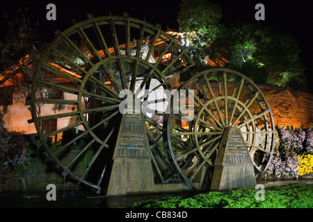 China Yunnan Lijiang Waterwheel in old town main square - Stock Photo
