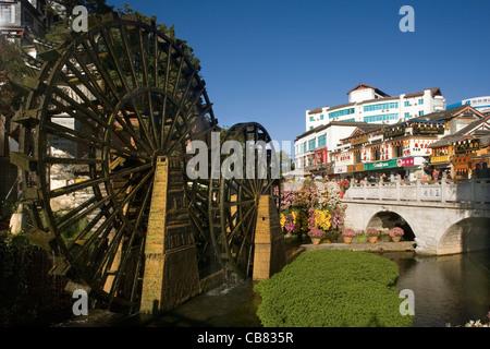 China Yunnan Lijiang Waterwheel in old town main square - Stock Photo